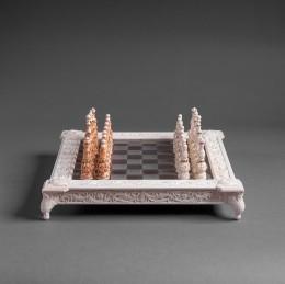 Шахматы из бивня мамонта и золота