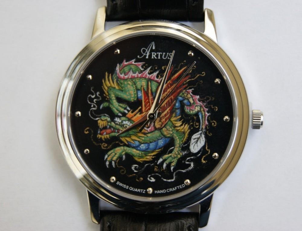 Часы драконы