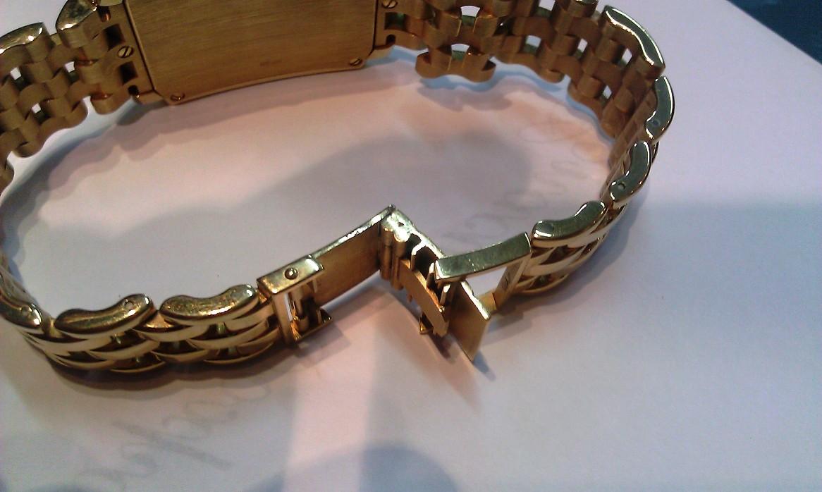 Замки на золотых браслетах фото